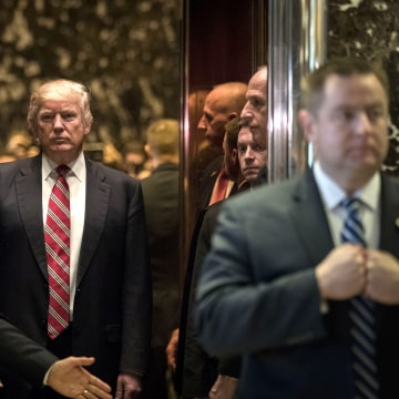 Image: President-elect Donald Trump heads back into the elevator after a meeting at Trump Tower, Jan. 16, 2017 in New York, N.Y.