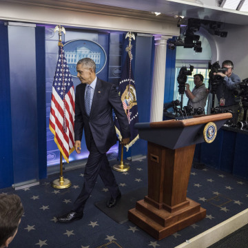 Image: Obama departs the Brady Press Briefing Room after his last press conference