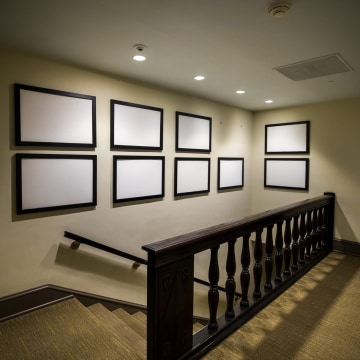 Image: Picture frames that once displayed photographs of President Barack Obama now sit empty in the West Wing of the White House