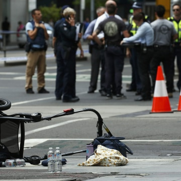 Image: A stroller is seen after a car hit pedestrians in central Melbourne