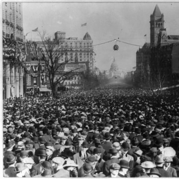 Image: The enormous crowd marched down Pennsylvania Ave., looking toward the Capitol and past old Post Office.