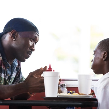 "Image: Mahershala Ali and Alex R. Hibbert in ""Moonlight"""