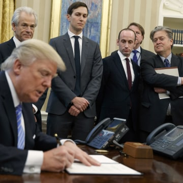 Image: Trump signs executive orders, Jan. 23, 2017.
