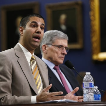 Image: FCC Commissioner Ajit Pai and FCC Chairman Tom Wheeler testify at a House Appropriations Financial Services and General Government Subcommittee hearing on Capitol Hill in Washington on March 24, 2015.