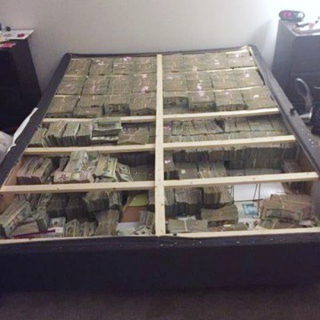 Image: A box spring full of $20 million in cash was seized following the arrest of a Brazilian national