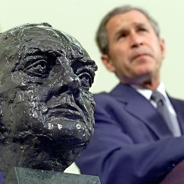 Image: George W. Bush listens