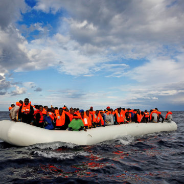Image: An overcrowded raft drifts out of control in the central Mediterranean Sea