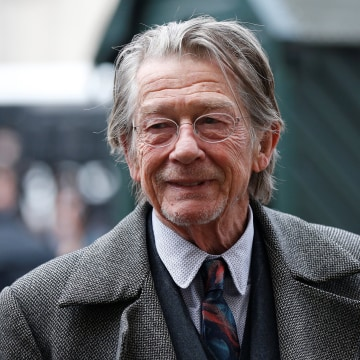 Image: FILE PHOTO: Actor John Hurt arrives for a memorial service for actor and director Richard Attenborough at Westminster Abbey in London