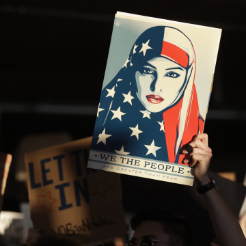 Image: A protester holds a sign at San Francisco International Airport during a demonstration to denounce President Donald Trump's executive order that bars citizens of seven predominantly Muslim-majority countries from entering the U.S. on Jan. 28 in San