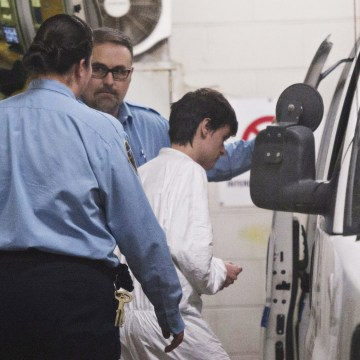 Image: Alexandre Bissonnette is escorted to a van after appearing in court