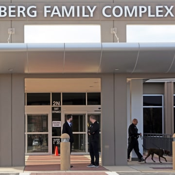 Image: Adults and children return to St. Louis Jewish Community Center on Jan. 18 in St. Louis, Missouri after canine units cleared the building.