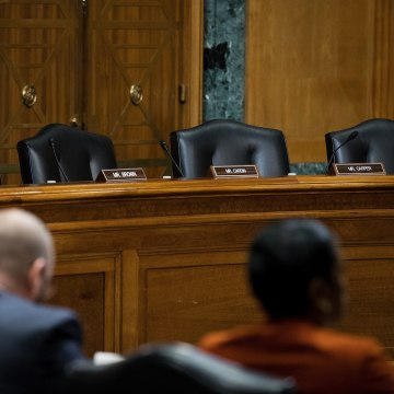 Image: A view of empty Democrat seats during a meeting of the Senate Finance Committee to vote on the nominations of cabinet nominees Tom Price and Steve Mnuchin