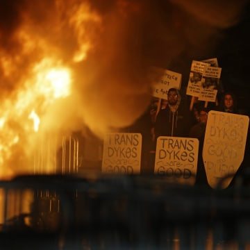 Image: Protesters watch a bonfire on Sproul Plaza during a rally against the scheduled speaking appearance by Breitbart News editor Milo Yiannopoulos on the University of California at Berkeley campus on Feb. 1, 2017, in Berkeley, Calif.