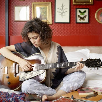 Gaby Moreno playing guitar