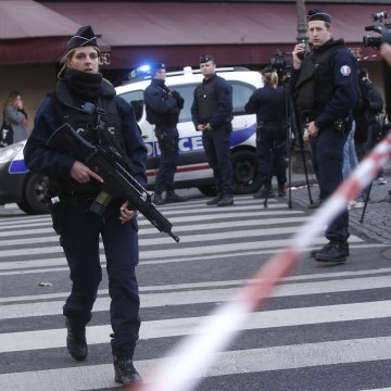 Image: Police officers take position outside the Louvre museum