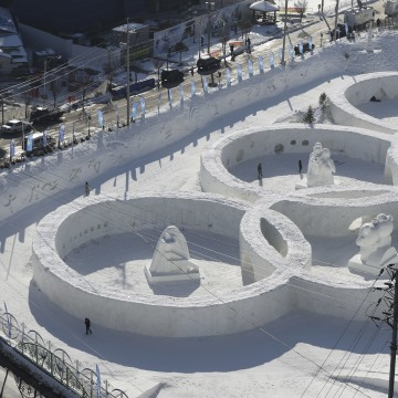 Image: A snow sculpture in the shape of the Olympic rings