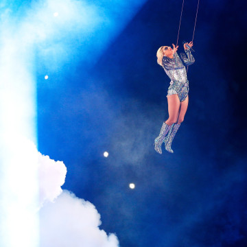 Image: Lady Gaga drops from the roof of the NRG Stadium in Houston.