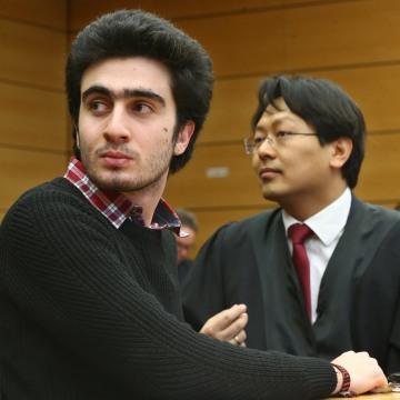 Image: Syrian refugee Anas Modamani and his lawyer Chan-jo Jun