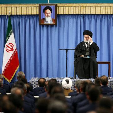 Image: Ayatollah Ali Khamenei waves as he delivers his speech Tuesday.