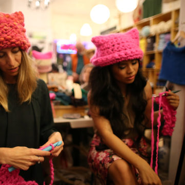 Image: Jayna Zweiman and Krista Suh take part in the Pussyhat social media campaign they created to provide pink hats for protesters in the women's march in Washington, D.C., the day after the presidential inauguration, in Los Angeles, California