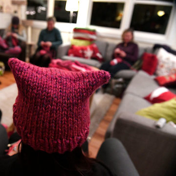 Members of the Pussyhat Project knit dozens of pink hats for people to wear in Washington DC during the inauguration of Donald Trump in Lafayette, Colorado.