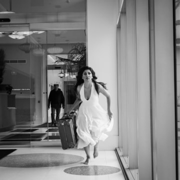 "Minita Gandhi carries her father's suitcase in her one-woman show, ""MUTHALAND."""