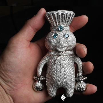 A four-inch Pillsbury Doughboy pendant smothered in diamonds from IF & Co