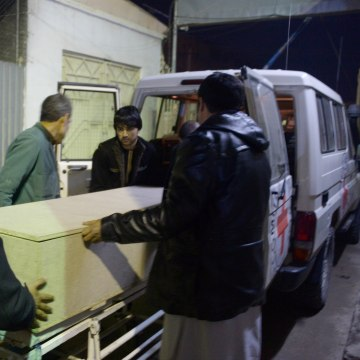 Image: Afghan men unload a coffin of an International Committee of the Red Cross (ICRC) employee, who was killed by gunmen in Jwzjan province, at a hospital in Mazar-i-Sharif, Afghanistan on Feb. 8.