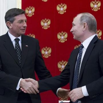 Image: Vladimir Putin (R) shakes hands with his Slovenian counterpart Borut Pahor following talks at the Kremlin on Friday.