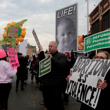 Image: Supporters of Planned Parenthood rally next to anti-abortion activists outside a Planned Parenthood clinic in Detroit, Michigan