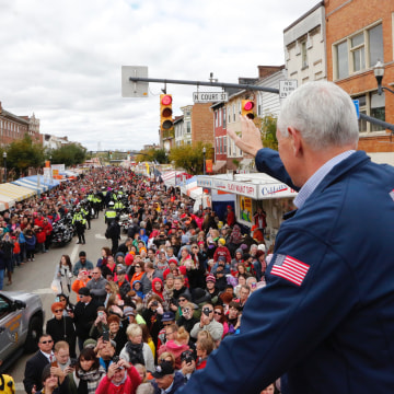 Image: Mike Pence, then-vice presidential candidate, waves to thousands at the annual Circleville Pumpkin Show on October 22, making the pit stop through the Ohio town that ultimately swung overwhelming Republican and helped the ticket win the state on El