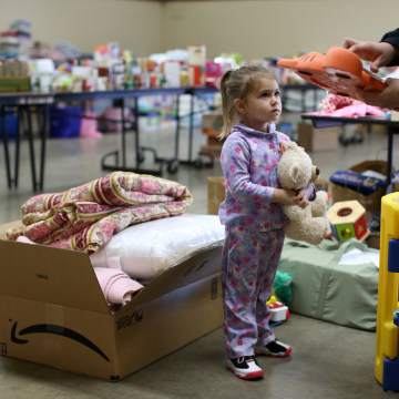 Image: Emma Neurohr, 4, of Oroville, watches her mother at the Salvation Army relief center at the Placer County Fairgrounds in Roseville, California, after an evacuation was ordered for communities downstream from the dam in Oroville