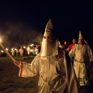 "Image: Members of the Ku Klux Klan participate in cross burnings after a ""white pride"" rally in rural Paulding County"