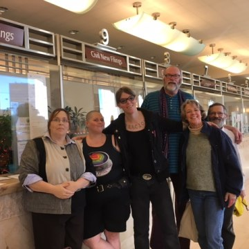 Photo of nonbinary petitioners in San Francisco Superior Court