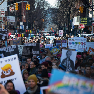 Image: People protest at a rally in front of the Stonewall Inn in solidarity with immigrants, asylum seekers, refugees, and the LGBT community on Feb. 4, 2017 in New York.