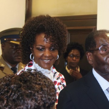 Image: President Robert Mugabe and his wife Grace arrive to chair ZANU PF's Politburo meeting at the party headquarters in Harare