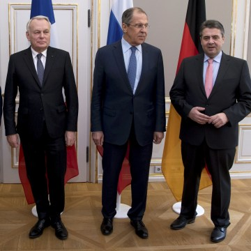 Image: Foreign Ministers of Ukraine Pavlo Klimkin, France Jean-Marc Ayrault, Russia Sergey Lavrov and Germany Sigmar Gabriel pose for a photograph during the 53rd Munich Security Conference in Munich