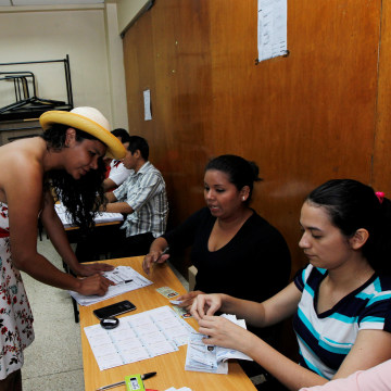 Image: Diane Rodriguez, a member of the Ecuadorean transgender community, registers before casting her vote during the presidential election in Guayaquil