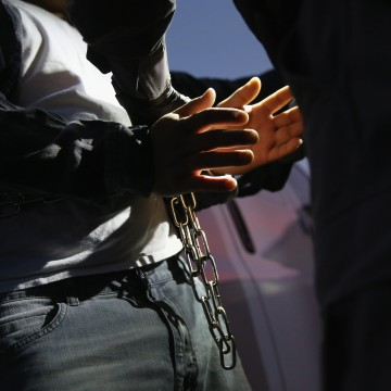 Image: A man is detained by Immigration and Customs Enforcement (ICE), agents early on Oct. 14, 2015 in Los Angeles, Calif.