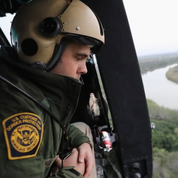 Image: A U.S. Customs and Border Protection helicopter crew searches for illegal immigrants