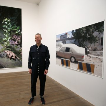 Image: Artist Wolfgang Tillmans poses for photographs among his latest exhibition at Tate Britain, in London