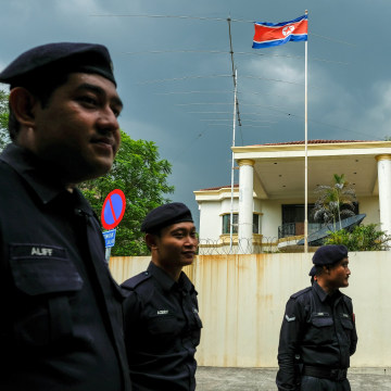 Image: Malaysian police outside the North Korean Embassy in Kuala Lumpur