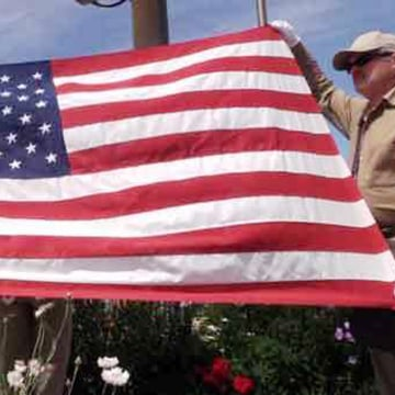 Image: Incarcerated veterans prepare the Stars and Stripes for the morning flag-raising at the Stafford Creek Corrections Center in Washington state.