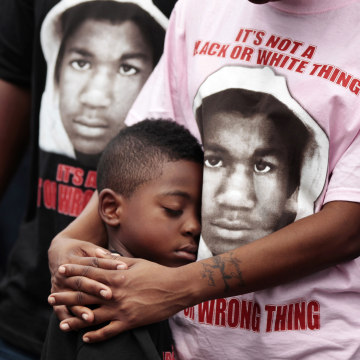 Image: LeTasha Brown stands with her arms around Anthony Dixon Jr. during an NAACP march and rally to the front of the Sanford Police Department for Trayvon Martin in Sanford, Florida, March 31, 2012.
