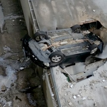 Image: A vehicle drove off a parking garage and landed in a building below Sunday afternoon, Feb. 26, 2017, Houston, Texas.