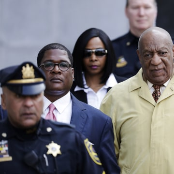 Image: Bill Cosby departs after a pretrial hearing in his sexual assault case