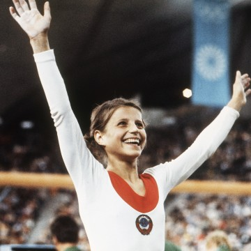 Image: Olga Korbut, of Russia, throws up her arms in joy after winning the Individual Women's Gymnastic event at the 1972 Summer Olympics in Munich, Germany, Aug. 1972