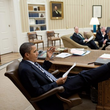 Image: Obama holds a meeting in the Oval Office in February 2011