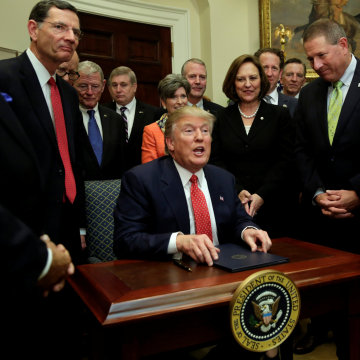 Image: U.S. President Donald Trump talks to the media after signing the water executive order at the White House, in Washington