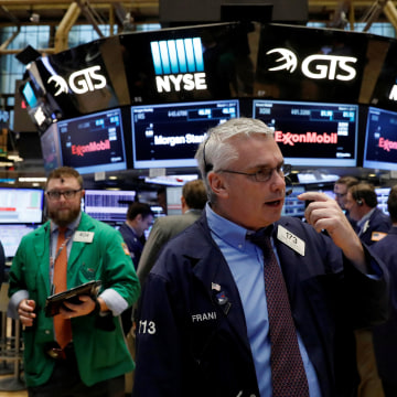 Image: A trader works on the floor of the New York Stock Exchange (NYSE) in New York
